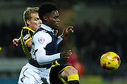 Burton Albion defender Damien McCrory clears the ball from Millwall FC's Fred Onyedinma during the Sky Bet League 1 match between Burton Albion and Millwall at the Pirelli Stadium, Burton upon Trent, England on 1 December 2015. Photo by Aaron Lupton.