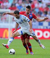 Fotball<br /> EM 2012<br /> 12.06.2012<br /> Tsjekkia v Hellas<br /> Foto: Witters/Digitalsport<br /> NORWAY ONLY<br /> <br /> v.l. Giorgios Karagounis, Milan Baros (Tschechien)<br /> Fussball EURO 2012, Vorrunde, Gruppe A, Griechenland - Tschechien