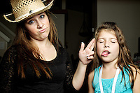 Felicia's finger shoots her sister Rheana while they help me test out my new Einstein studio strobes in the living room Wednesday, October 12, 2011.