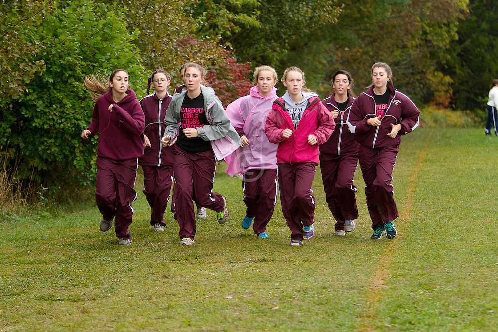 Festival of Champions High School Cross Country meet, Caribou girls team, warmup