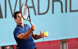 May 8, 2018 - Madrid, Spain - Guillermo García López of Spain returns the ball to Ryan Harrison of USA in the 2nd Round match during day four of the Mutua Madrid Open tennis tournament at the Caja Magica. (Credit Image: © Manu Reino/SOPA Images via ZUMA Wire)