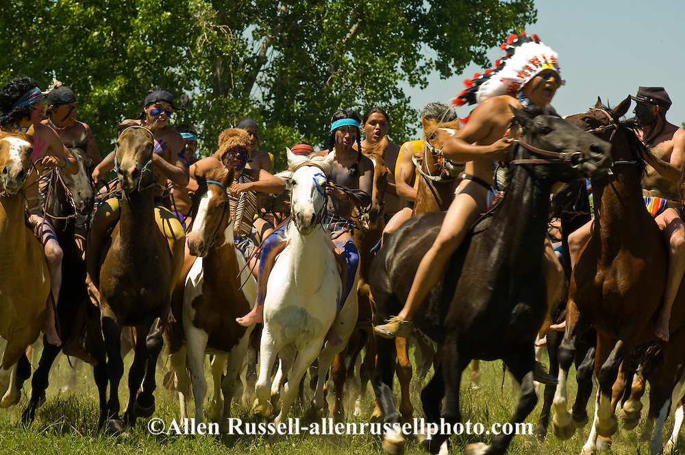 Custers Last Stand Reenactment, Battle of the Little Bighorn, Crow Indian Reservation, Montana, indian warriors attack 7th Cavalry.