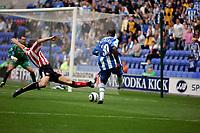 Photo: Peter Phillips.<br /> Wigan Athletic v Sunderland. The Barclays Premiership.<br /> 27/08/2005.<br /> Jason Roberts blasts a shot through but the effort was blocked by keeper Kelvin Davis