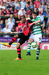 Yeovil Town's Richard Hinds gets to the ball before Bournemouth's Wes Thomas - Photo mandatory by-line: Dougie Allward/Josephmeredith.com  - Tel: Mobile:07966 386802 08/09/2012 - SPORT - FOOTBALL - League 1 -  Yeovil  - Huish Park -  Yeovil Town v AFC Bournemouth