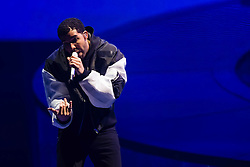 © Licensed to London News Pictures. 24/03/2014. London, UK.   Drake performing live at The O2 Arena.  In this picture - Aubrey Drake Graham (Drake).  Drake is an award winning Canadian recording artist, rapper, songwriter, and actor.  Drake has sold over 5 million albums worldwide & his work has earned him a Grammy Award, three Juno Awards, and six BET Awards.   Photo credit : Richard Isaac/LNP