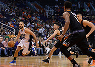 Mar 17, 2017; Phoenix, AZ, USA; Orlando Magic guard Evan Fournier (10) drives by Phoenix Suns guard Devin Booker (1) in the first half of the NBA game at Talking Stick Resort Arena. Mandatory Credit: Jennifer Stewart-USA TODAY Sports