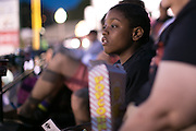Shamir Douglass, 11, watches the Red Wings game at Frontier Field in Rochester on Friday, July 31, 2015. Students from School #17 ate dinner at the stadium, and then camped on the field Friday night.