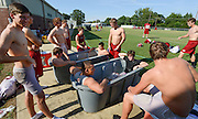 Decatur Daily/Gary Cosby Jr.     Hartselle High prepares for this weekend's game with Lawrence County.  Players literally chill out in ice water baths after practice.  In the near tub is Zac Pershin and Connor Shelton.  In the rear tub is Waid Miller and Jorden Robinson.