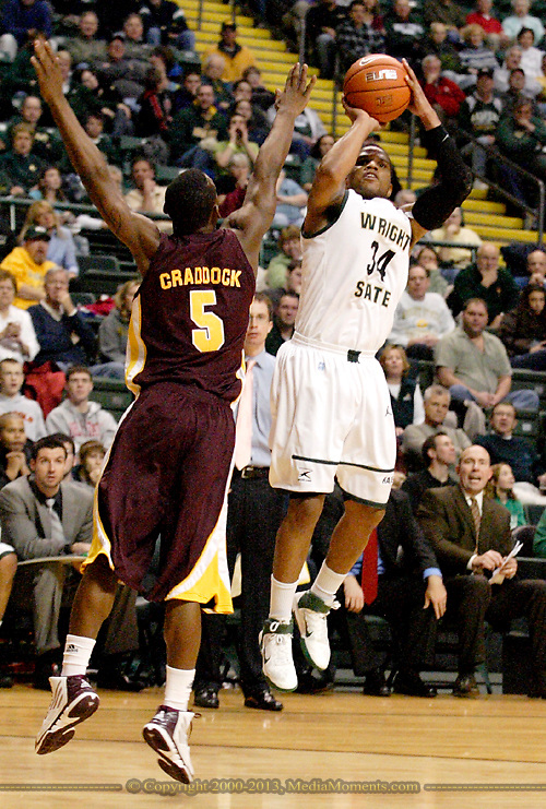 CMU Finis Craddock (5) and WSU junior Julius Mays (34) as the Central Michigan Chippewas play the Wright State University Raiders at the Nutter Center, Thursday, December 22, 2011.