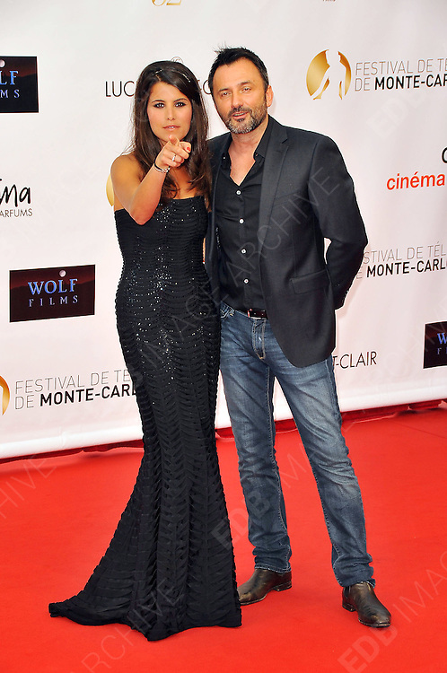 10.JUNE.2012. MONACO<br /> <br /> FREDRIC LOPEZ AND KARINE FERRI ATTEND THE OPENING CEREMONY OF THE 52ND MONTE CARLO TELEVISION FESTIVAL HELD AT THE GRAMALDI FORUM.  <br /> <br /> BYLINE: EDBIMAGEARCHIVE.CO.UK<br /> <br /> *THIS IMAGE IS STRICTLY FOR UK NEWSPAPERS AND MAGAZINES ONLY*<br /> *FOR WORLD WIDE SALES AND WEB USE PLEASE CONTACT EDBIMAGEARCHIVE - 0208 954 5968*