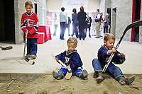 Vinny Hughes, 3, right, Roman Hughes, 2, center, and their brother Dante Hughes, 6, play in the dirt at the unfinished KYRO ice rink prior to an event Thursday by Frontier announcing they would sponsor the facility which will be called the Frontier Ice Arena.