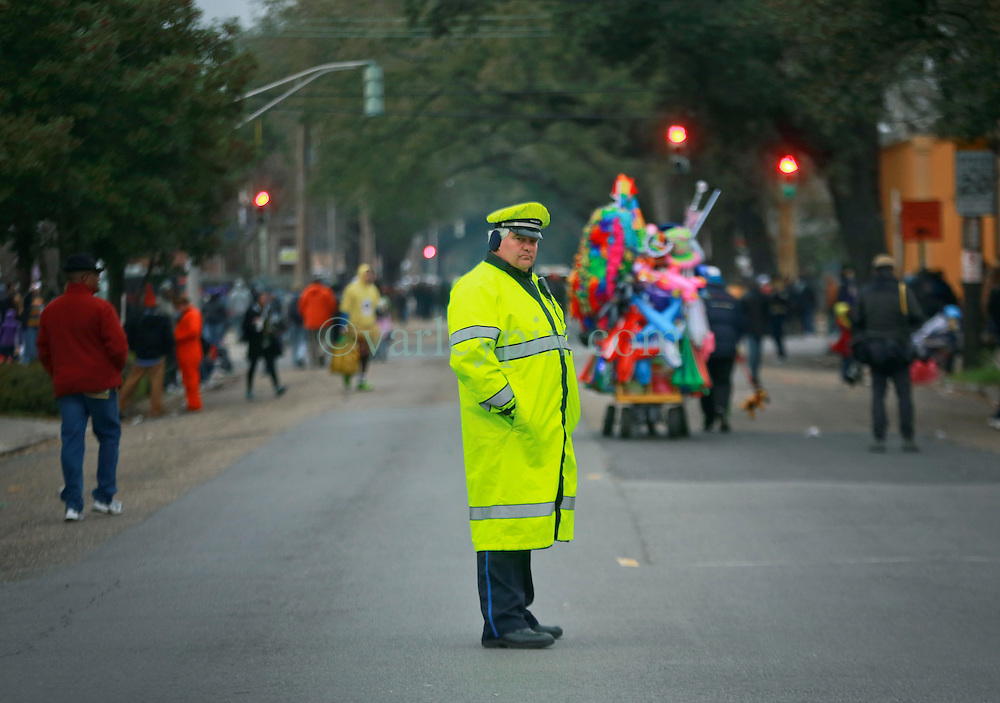 04 March 2014. New Orleans, Louisiana.<br /> NOPD Detective Winston Harbin of internet dance fame for the much viewed internet video of him doing the 'Wobble' and 'Cupid Shuffle,' as he awaits the early morning Krewe of Zulu on the streets of New Orleans.<br /> Photo; Charlie Varley/varleypix.com<br /> <br /> http://www.nola.com/mardigras/index.ssf/2014/03/for_mardi_gras_cop_trades_case.html<br /> <br /> http://www.nola.com/mardigras/index.ssf/2014/03/nopds_wobble_cop_adds_cupid_sh.html#incart_maj-story-1