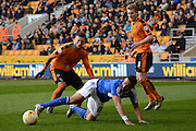 Ipswich Town midfielder Liam Feeney slips over watched by Wolverhampton Wanderers defender Matt Doherty and Wolverhampton Wanderers midfielder George Saville   during the Sky Bet Championship match between Wolverhampton Wanderers and Ipswich Town at Molineux, Wolverhampton, England on 2 April 2016. Photo by Alan Franklin.