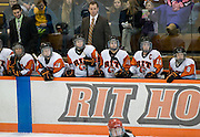 2012/03/04 - RIT head coach Scott McDonald (standing, right) is seen during the ECAC West Championship game between RIT and SUNY Plattsburgh at RIT's Ritter Arena on March 4th, 2012. RIT lead 1-0 after one period of play.