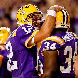 October 16, 2010; Baton Rouge, LA, USA; LSU Tigers quarterback Jarrett Lee (12) congratulates running back Stevan Ridley (34) following a touchdown against the McNeese State Cowboys during the first half at Tiger Stadium.  Mandatory Credit: Derick E. Hingle