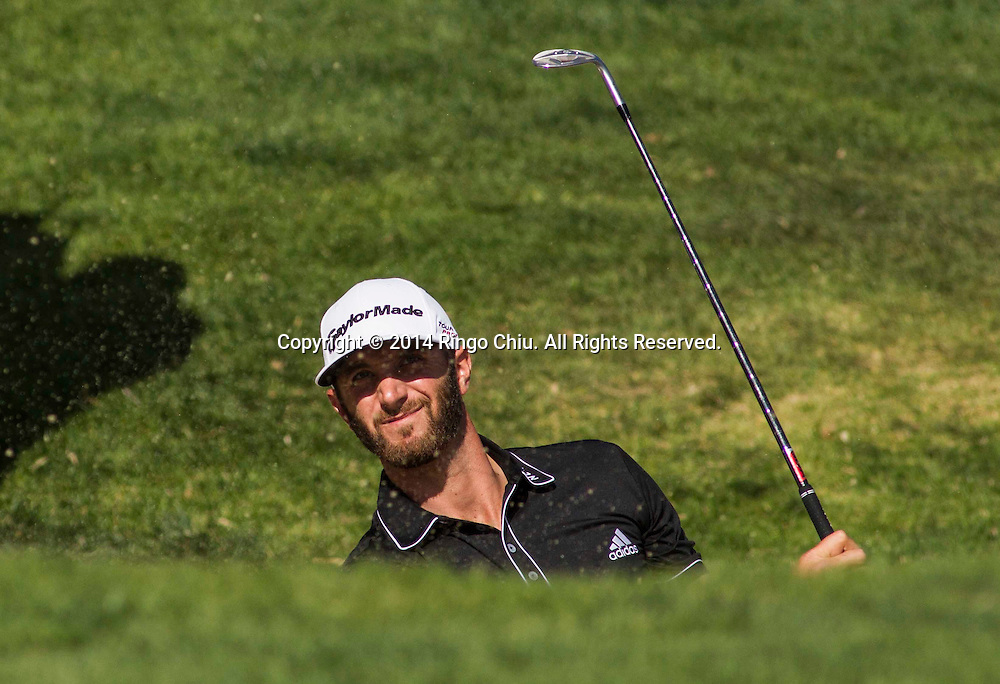 Dustin Johnson looks at his shot in the final round of the PGA Tour Northern Trust Open golf tournament at Riviera Country Club in the Pacific Palisades area of Los Angeles Sunday, February 16, 2014. Bubba Watson won the Northern Trust Open.<br />  (Photo by Ringo Chiu/PHOTOFORMULA.com)