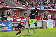 defender Marvin McCoy & defender Danny Butterfield during the Sky Bet League 2 match between Exeter City and York City at St James' Park, Exeter, England on 22 August 2015. Photo by Simon Davies.