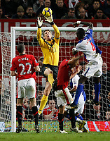 Photo: Steve Bond/Richard Lane Photography. Manchester United v Blackburn Rovers. Barclays Premiership 2009/10. 31/10/2009. Keeper Edwin Van der Sar safely collect sas Christopher Samba (R) challanges