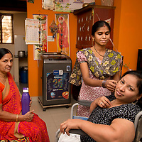 India April 2017. Bangalore. Leonard Cheshire. Saritha, works at Accenture. At home with mother and Annapurna, her sister in law.