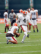 Cleveland Browns punter Reggie Hodges (2) holds as kicker Phil Dawson (4) fakes a field goal during NFL football training camp at the Cleveland Browns Training Complex on Monday, August 9, 2010 in Berea, Ohio. (©Paul Anthony Spinelli)