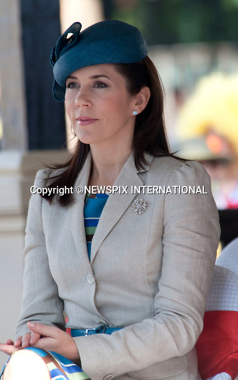 """CROWN PRINCESS MARY.watches a street arts prefomance in the capital Hanoi. .Queen Margrethe, Crown Prince Fredrik and Crown Princess Mary were accompanied by  the President Nguyen Minh Triet, Hanoi, Vietnam_03/11/2009.The Danish Royal Family on their State Visit to Vietnam watch a street arts prefomance in the capital Hanoi. .Queen Margrethe, Crown Prince Fredrik and Crown Princess Mary were accompanied by  the President Nguyen Minh Triet, Hanoi, Vietnam_03/11/2009..Mandatory Photo Credit: ©Dias/Newspix International..**ALL FEES PAYABLE TO: """"NEWSPIX INTERNATIONAL""""**..PHOTO CREDIT MANDATORY!!: NEWSPIX INTERNATIONAL(Failure to credit will incur a surcharge of 100% of reproduction fees)..IMMEDIATE CONFIRMATION OF USAGE REQUIRED:.Newspix International, 31 Chinnery Hill, Bishop's Stortford, ENGLAND CM23 3PS.Tel:+441279 324672  ; Fax: +441279656877.Mobile:  0777568 1153.e-mail: info@newspixinternational.co.uk"""