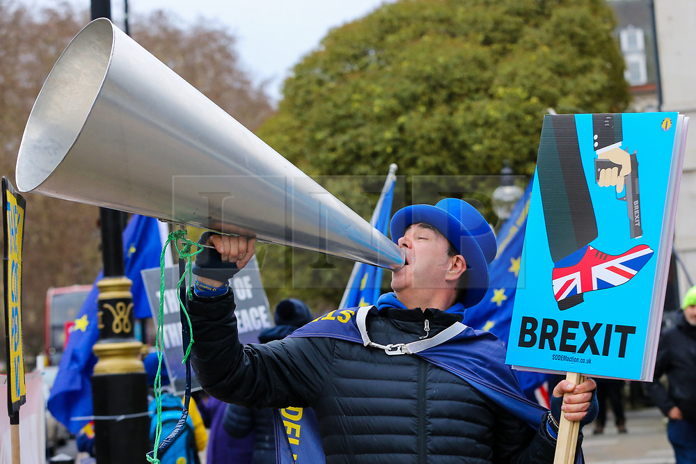 © Licensed to London News Pictures. 01/01/2019. London, UK. Steven Bray founder of SODEM (Stand of Defiance European Movement) with placards protest outside the Houses of Parliament in central London. Photo credit: Dinendra Haria/LNP