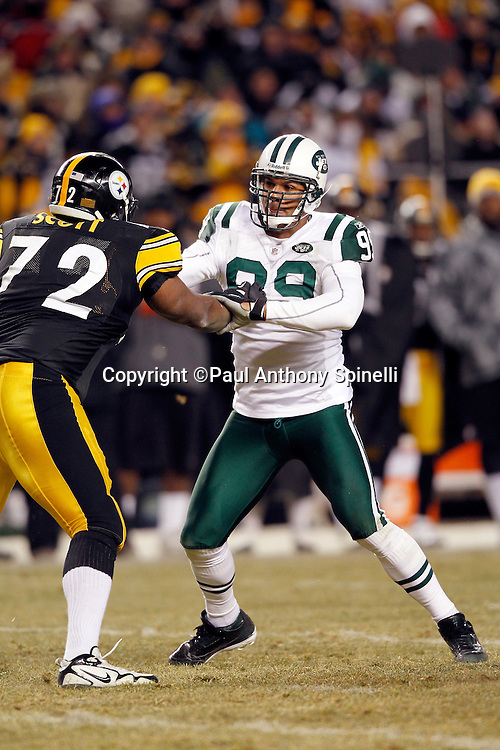 New York Jets linebacker Jason Taylor (99) works his way around a block by Pittsburgh Steelers offensive tackle Jonathan Scott (72) during the NFL 2011 AFC Championship playoff football game against the Pittsburgh Steelers on Sunday, January 23, 2011 in Pittsburgh, Pennsylvania. The Steelers won the game 24-19. (©Paul Anthony Spinelli)