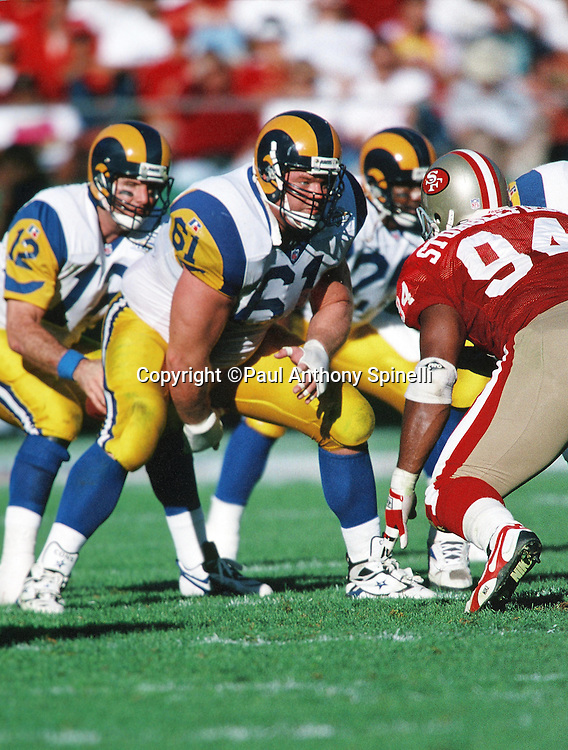 St. Louis Rams center Rich Saul (61) snaps the ball during the NFL football game against the San Francisco 49ers on Nov. 26, 1995 in San Francisco. The 49ers won the game 41-13. (©Paul Anthony Spinelli)