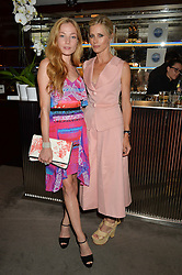 The UK Premier of Johnnie Walker Blue Label's 'Gentleman's Wager' - a short film starring Jude Law was held at The Bulgari Hotel & Residences, 171 Knightsbridge, London on 22nd July 2014.<br /> Picture Shows:-Left to right, CLARA PAGET and LAURA BAILEY.