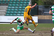 Ryan Dickson of Yeovil Town lands awkwardly after challenging David Pipe of Newport County during the EFL Sky Bet League 2 match between Newport County and Yeovil Town at Rodney Parade, Newport, Wales on 14 April 2017. Photo by Andrew Lewis.