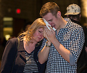 A pair of mourners comfort each other during a community gathering for the victims of the Brentwood stabbing at MacEwan Hall on the University of Calgary campus in Calgary on Tuesday April 15, 2014. (Jenn Pierce/Calgary Herald)