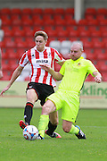 Asa Hall and Gary Jones during the Vanarama National League match between Cheltenham Town and Southport at Whaddon Road, Cheltenham, England on 15 August 2015. Photo by Antony Thompson.