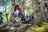 Thibault Lady finding his way in through the woods during his qualifying round at the UCI Mountain Bike World Cup in Fort William, Scotland.