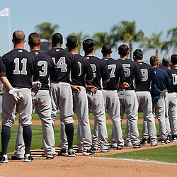 February 27, 2011; Clearwater, FL, USA; New York Yankees players stand during the national anthem prior to a spring training exhibition game against the Philadelphia Phillies at  Bright House Networks Field. Mandatory Credit: Derick E. Hingle