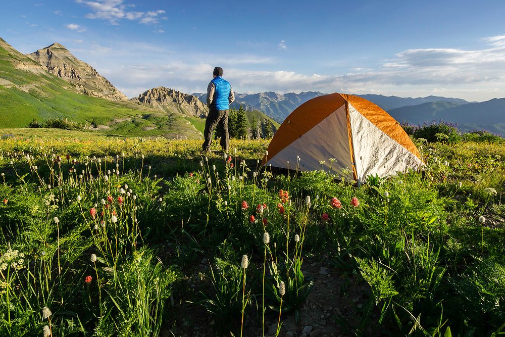 A backcountry camper admires the views of Mt. Timpanogos in Utah's Wasatch Mountains.