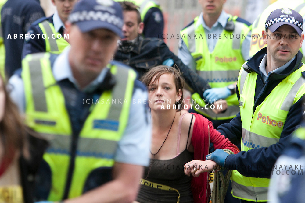 © Licensed to London News Pictures. 21/010/2011. Melbourne, Australia. Protester being carried away by police during occupy Melbourne Protest in Melbourne's central business district. Photo credit : Asanka Brendon Ratnayake/LNP