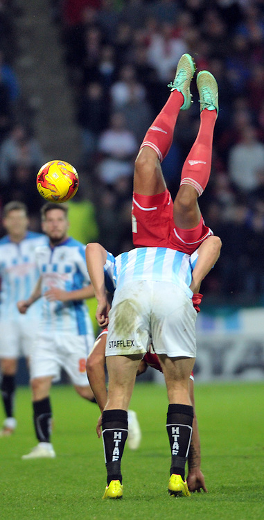 Grant Holt of Huddersfield Town tangles with Jamaal Lascelles of Nottingham Forest during the Sky Bet Championship match at the John Smiths Stadium, Huddersfield<br /> Picture by Graham Crowther/Focus Images Ltd +44 7763 140036<br /> 01/11/2014