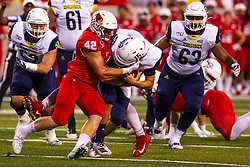 NORMAL, IL - September 21: Dylan Draka stops Cole Cookus in his tracks during a college football game between the ISU (Illinois State University) Redbirds and the Northern Arizona University (NAU) Lumberjacks on September 21 2019 at Hancock Stadium in Normal, IL. (Photo by Alan Look)