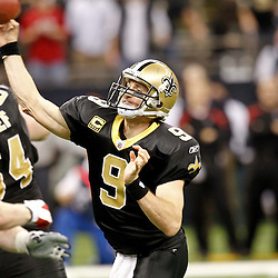 December 26, 2011; New Orleans, LA, USA; New Orleans Saints quarterback Drew Brees (9) during a game against the Atlanta Falcons at the Mercedes-Benz Superdome. The Saints defeated the Falcons 45-16.  Brees broke the NFL single-season passing record formerly held by Miami Dolphins quarterback Dan Marino on a 9-yard touchdown throw to Darren Sproles. Mandatory Credit: Derick E. Hingle-US PRESSWIRE