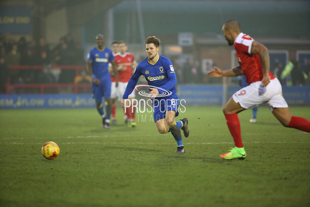 AFC Wimbledon midfielder Jake Reeves (8) battles for ball with Charlton Athletic striker Josh Magennis (9) during the EFL Sky Bet League 1 match between AFC Wimbledon and Charlton Athletic at the Cherry Red Records Stadium, Kingston, England on 11 February 2017. Photo by Matthew Redman.