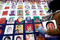 Nederland. Den haag, 19 februari 2004.<br />Kunstenaars hebben 300 schilderijen gemaakt van kinderen die onder de regeling van minister Verdonk uitgezet zullen worden. De portretten werden op een groot rood-wit-blauw doek opgehangen. Generaal pardon. Asielzoekers. Uitzettingsbeleid.<br /><br />Foto Martijn Beekman<br />niet voor trouw,ad,parool en nrc