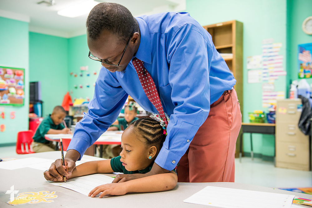 Teacher Jonathan Clausell with a student at Trinity Evangelical Lutheran School on Monday, April 7, 2014, in Mobile, Ala. LCMS Communications/Erik M. Lunsford