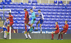READING, ENGLAND - Wednesday, March 12, 2014: Reading's goalkeeper Lewis Ward challenges for a header against Liverpool during the FA Youth Cup Quarter-Final match at the Madejski Stadium. (Pic by David Rawcliffe/Propaganda)