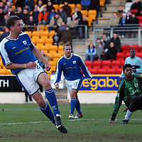 St Johnstone v Raith Rovers..26.12.04<br />Ian Maxwell slots home his goal passed keeper Rudy Pounoussamy<br /><br />Picture by Graeme Hart.<br />Copyright Perthshire Picture Agency<br />Tel: 01738 623350  Mobile: 07990 594431