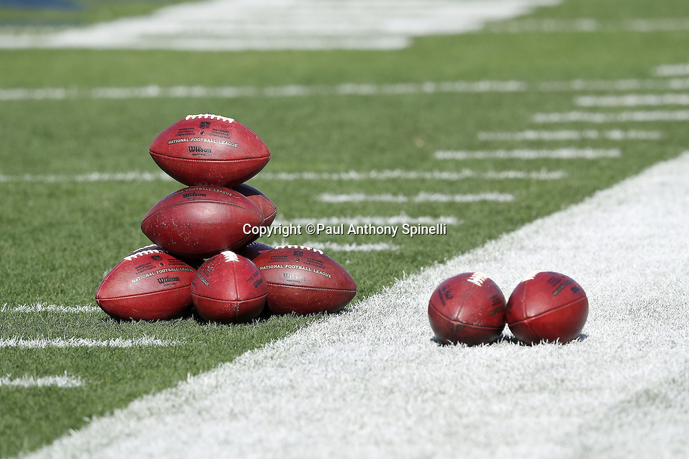NFL footballs are stacked up and read for the Los Angeles Rams 2016 NFL preseason football game against the Kansas City Chiefs on Saturday, Aug. 20, 2016 in Los Angeles. The Rams won the game 21-20. (©Paul Anthony Spinelli)