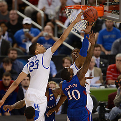 Apr 2, 2012; New Orleans, LA, USA; Kansas Jayhawks guard Tyshawn Taylor (10) has his shot blocked by Kentucky Wildcats forward Anthony Davis (23) as forward Terrence Jones (behind #10) defends during the second half in the finals of the 2012 NCAA men's basketball Final Four at the Mercedes-Benz Superdome. Mandatory Credit: Derick E. Hingle-US PRESSWIRE