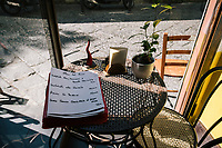 "NAPLES, ITALY - 10 OCTOBER 2018: The daily menu is seen here at the entrance of La Taverna a Santa Chiara, a tavern in the historical center of Naples, Italy, on October 10th 2018.<br /> <br /> The idea of the founders Nives Monda and Potito Izzo (two really unusual names in southern Italy) was to create a ""taste gate"" of Campania products. La Taverna a Santa Chiara, founded in 2013, is a modern tavern whose strengths are the choice of regional and seasonal products and mostly small producers. Small restaurant, small producers.<br /> The two partners tried to put producers and consumers in direct contact, skipping the distribution, and managing to reduce the costs of the products considerably. Nives and Potito managed to create a simple kitchen, at moderate costs but with high quality raw materials.<br /> ""A different restaurant idea,"" says Nives, ""the producers deliver their products at low prices and the tavern manages to make traditional dishes with niche products"".<br /> Nives Monda has been a labor consultant for 20 years. Potito Izzo is the chef who has always been loyal to the  family cuisine. When he embraced the idea of Nives he found in the tavern the natural place to express the tradition of Neapolitan cuisine. Nives defines him as a ""comfort food chef"". Their partnership is a true friendship that has lasted for over 10 years."