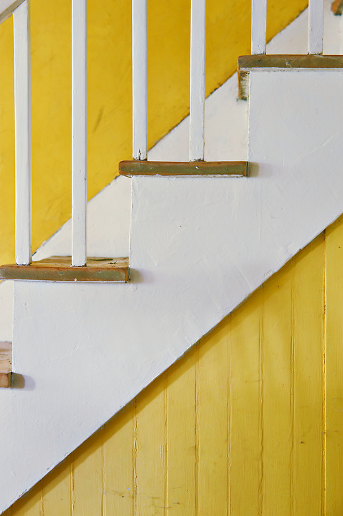 White staircase and yellow wall