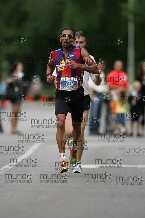 (Ottawa, ON --- May 30, 2010) DEVASHISH PAUL running in the half-marathon during the Ottawa Race Weekend. Photograph copyright Sean Burges / Mundo Sport Images