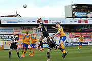 Grimsby Town defender Luke Waterfall (6) heads the ball clear  during the EFL Sky Bet League 2 match between Mansfield Town and Grimsby Town FC at the One Call Stadium, Mansfield, England on 4 January 2020.